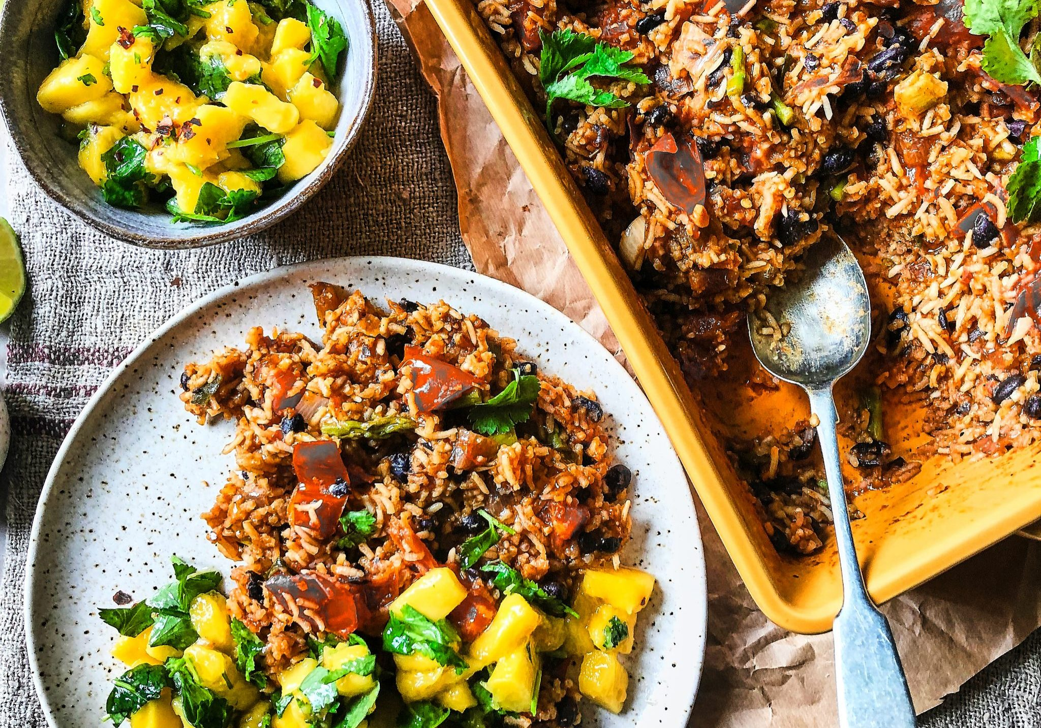 BakedMexican rice with beans and greens topped with mango salsa 1