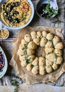 Olive bread roll wreath with caramelised onion hummus 5